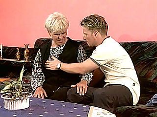 Blonde Granny Fucked : Granny Susan is just the type to welcome guest by letting them suckle her granny tits. This blonde gilf takes the time out to pleasure this hot young hunk by bouncing up and down his stiff rod and then bending over so he could fuck her hard from behind.