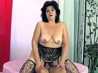 Cock Riding Granny : We caught Emily browsing through some naughty magazines and then plugging her pussy with a red dildo. When my friend here cant take it anymore, he had this hot grandma on her knees and fucked the hell out of her before he flipped her so she could ride him hard.