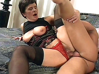 Cock Riding Granny : Hot Jozsefne really was raring hot that day and her sexy lingerie was proof that she was ready for it. She eagerly fondled her huge granny tits while sucking on a huge cock before pushing him down so she could ride his thick shaft hard and fast.