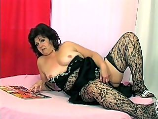 Granny Emily Fucked : Emily sure looked yummy in her lacy black stockings and lingerie. She was plugging her pussy full with a red dildo when my friend decided that she should have the real thing shoved up her pussy, hammering deep into her granny hole. She sure agreed to it.