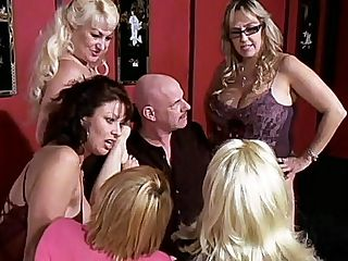 Granny Gangbang : There is no stopping these hot grannies from having their fun. Dana Hayes, Raquel, Vanessa Videl, Wanda Lust and Ginni Lewis are about to toy with poor grandpa here as they make him suck their tits and then dive down to munch on their hairless hot holes.