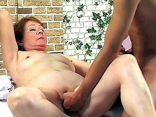 Hard Knobbed Grandma : Granny Nathalie was so lonely, that she started rubbing her tits and playing with her pussy. Good thing a hot guy came to her rescue and helped her shove the big black dildo up her pussy before fucking her with his huge hard knob instead.