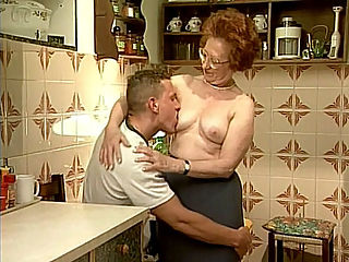 Kitchen GILF Fucking : Sabrina is always thinking about pleasing her guest and this time, shes invited a hot young stud over. But instead of food, this hot granny plans on serving her mature pussy for him right there on the kitchen counter where she got a good hardcore banging.