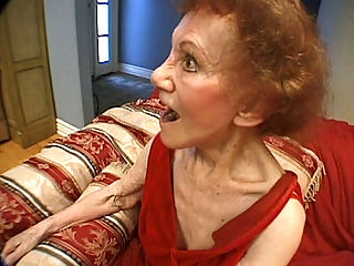 Living Room GILF Threesome : Lindas cocksucking skills are truly topnotch and my friend and I here are enjoying her oral ministrations. This naughty granny wanted two cocks for her so she could have a cock to suck on while shes getting banged hard and fast on her living room couch.