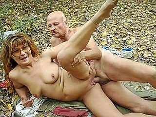 Outdoor Fucking Granny : Hot granny Szandra loves to take on strolls and its because she gets the chance to meet her lover. The moment they get together, they strip down and lay on the forest floor where Szandra rides him hard and then sucks him hard cock after.