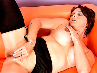 Sensual red head Foxy plays with her pussy at Anilos
