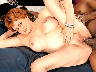 Valerie Teaches A Black Stud A Lesson In Fucking MILFs : Valerie, a retired school teacher from Atlanta, Georgia, is married, but her husband doesnt mind that shes gone off to 60PLUSMILFs to get fucked by a hung black stud.brbr My husband gets off on me doing this, she said. He doesnt mind that I have gang bangs with hung black guys. He gave me a gang bang as a 69th birthday present. And he was fine with me coming here and fucking a stranger or two. As long as I give him the dirty details!brbr Valerie didnt flinch when she saw the size of Lucass cock. The bigger the better, she said. I can take it. I just wish I had found out about hung, black studs earlier in life.brbr Lucas pumps Valeries pussy hard, and then when his balls are about to explode, he withdraws and cums all over Valeries face and big tits.brbr Yes, I enjoyed it, Valerie said. Who wouldnt?brbr Well, we wouldnt, Valerie. But we definitely enjoy watching you loving it.