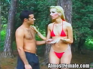 Trannie in tight red bikini gets ass fucking : If there was a Sports Illustrated for trannie chicks this girl would get the cover. Here she is showing off her slamming body to the world. The man shes with is extremely aroused and has to fuck her right then and there in the woods. She doesnt mind at all. She loves that she can turn men on to this point.