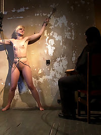 Tall hot blonde on tip-toes hanging from a crotch rope, made to squirt. : Sgt. Major continues his abuse of tall hot blonde Dylan. This time, shes bound to the wall and pleading for mercy. Instead, a crotch rope is hiked up, forcing her onto her tip-toes. In this position, her clit and pussy are nicely exposed - an opportunity the Sarge isnt about to pass up. Dylans pussy is attacked first with a vibe, then the Sarges adept fingers. Finally, helplessly, this sexy bitch is squirting pussy juice out onto the floor reduced to her most base instincts. In the end, her pleasure is only fleeting as the Sarge is always generous with the gift of pain.