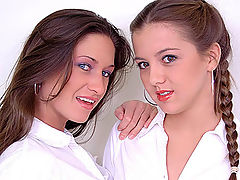 A Feminine Touch : Two pretty girls kiss and rub each others wet pussy