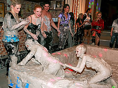 Dirty Duo Turns Into Mud Brawl : As if watching babes Lexxis and Katy wasnt enough mud splattering messiness, this hardcore muddy wrestling match goes from your standard duo battle to an all out mud brawl, with a crazy group of chicks and one lucky dude hopping in the mud ring and going mud crazy!