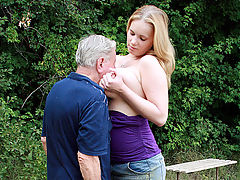 Busty babe bangs a senior : Lizzy is in the forest, basking in the sunshine when she notices a funny old man who is peeking at her from the bushes. Without any ado she decides to punish the pervert by first smothering him with her tits and then fucking him to near death!