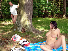 Peeping Tom : Bert is having a quiet pee in the forest when he notices a girl with enormous tits sunbathing in the nude. Immediately he starts jerking off but when she sees him he finds out it is not easy to run when your trousers are on your ankles...