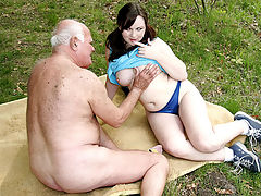 Grandpa loves teenage girls : Grandpa has got a new girlfriend, a lovely looking teenage girl. They go for a walk and park themselves on a blanket in the grass where the old man shows her his muscular body. Turned on she starts sucking his dick as an introduction to a long and horny fuck.