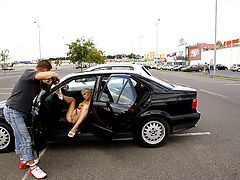 Fucked in a suburb : A nice looking blonde is on holiday with her boyfriend and she is nuts about sex in public. After a small snack she is ready to be fucked in public. They walk back to the car where the little slut pulls her panties aside and masturbates with the car doors wide open. Then they move to a busy suburb where she sucks his dick in the middle of a field. She throws her golden pumps into the air and takes his hard dick into her wet slit. She doesnt mind that everyone can see her. When her pussy is filled with sperm they walk back to the car.