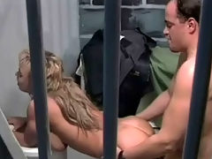Fucked in a prison cell : Three people are arguing with each other in an office. In the next scene, a guy is getting a blow job from a blonde girl in a prison cell. The girl leans over the toilet and he fucks her from behind while another prisoner watches them.