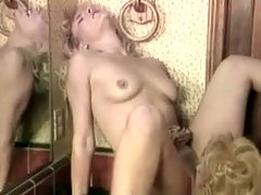 Lesbians in the bathroom : Two blonde girls are talking to each other in the bathroom. A little later one of them is licking the tits of the other one. Then the first girl sits down on top of the sink, spreads her legs wide to have her pussy licked by the other one.