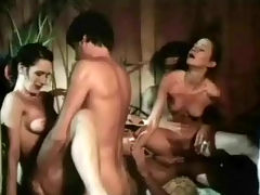 Fucking competition : Two guys are sitting in a hot tub watching two cheerleaders perform. A little later both girls are naked and busy sucking two guys while others cheer them on. Then both girls get fucked in varous positions.