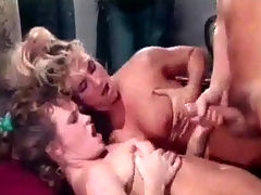 Catching the burglar : Two naked women are playing around under the shower while a naked guy is going through their clothes in the bedroom. When the girls come in they nearly fall over him. A little later he is licking one of them while the other sucks his dick.