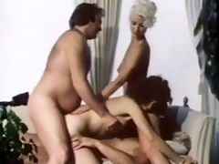 Vintage double fuck : a couple is laying down on the sofa fucking each other while a second girl is licking the first ones pussy. Then the first girl climbs on top of the guy and lowers herself over his dick. A second guy joins them and fucks the girl in her ass at the same time.