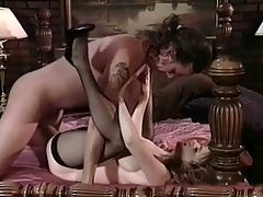Retro hardcore fuck : A naked guy is laying on a bed when an equally naked girl walks up to him. She leans forward so he can play with her tits. He licks her nipples, rubbing her pussy at the same time. A little later they move into 69 position, licking and suckin before he fucks her doggy style.