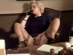 Vintage telephone sex : A blonde girl is on the telephone, talking about her fantasies. She is rubbing her crotch at the same time. A little later she puts the phone down and begins to rub her hairty pussy, moaning with pleasure.