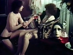 Lesbians in Amsterdam : In this vintage film we follow and American tourist who visits Amsterdam in the sixties. She ends up half naked in a room with another girl who is only wearing panties. The girl seduces her and a little later her hairy pussy is being licked.