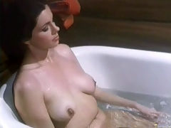 Masturbating in the bath : A young woman is in a bathroom. She disrobes, showing her firm tits, and then sits down in the bath tub. There she rubs her whole body gently, concentrating on her hairy pussy and her nipples. In the mean time another couple is having sex in the bedroom.