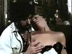 Stripping and fucking : A girl is taking her dress off while a guy who is standing behind her strokes her tits. They kiss and she rubs her pussy. They end up naked on the bed where the girl sucks his dick before she bends over so he can fuck her from behind.