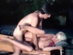 Fucking next to the pool : A blonde girl with large tits is sitting in an outdoor spa. A guy approaches her, takes his clothes off and then joins her in the water where he begins to lick her hairy pussy. She sucks his dick and then the both of them screw next to the pool.