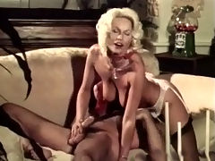 Hard fucking blonde : A blonde girl and a guy are on a couch exchanging French kisses. She slips out of her clothes and then she gets down on her knees in order to blow him, straddling his face to be licked. A little later she lowers her pussy over his cock.