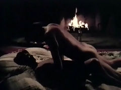 Screwing in front of the fireplace : A couple is fucking on the floor in front of an open fire. Every no and then the girl sucks the guys cock. Then he lies down on his back and she rides on top of him. But as soon as they have finished fucking the guy falls asleep.