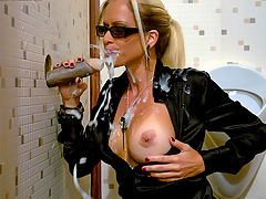 Cool Blonde Chick : Yeah this bitch is just too cool for words and when she spots the sperm shooter sticking through the wall she is not surprised at all. She calmly approaches it and soon is pinching and twisting her titties while giving it a stroke. The gallons of fake cum only turns her on more and she rubs her bald pussy faster and faster as the spunk covers her more and more.