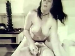 Interrupted lesbian fuck : Two young, naked girls are on a bed. One of them lays down and spreads her legs while the other covers a large dildo with lubricant. Just when they are fucking each other a guy enters. He licks one of the girls while the other sucks his dick.