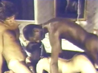 Interracial threesome : A couple is in the bedroom. He has the waistband of his robe wrapped around his dick. The girl pushes him onto the bed and unwraps his dick. A little later she is sucking it while she is fucked by a black man.