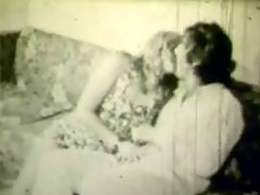 Busty blonde gets fucked : A blonde girl and a guy are sitting on a settee, kissing each other. The guy is squeezing her tits at the same time. When they have taken their clothes off the guy sits down and the girl climbs on top of his lap in order to fuck him.