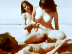 Sexy fata morgana : A guy is walking across a desert when he stumbles upon two naked girls. A little later he is on his back while one of the girls rides his cock. Then he jerks off above their faces and comes on their tits.