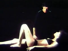 Blow job in black : A girl in a black bikini is laying on her back on a bed. A guy, also in black, approaches her and touches her gently. She takes out his dick and begins to suck it. Then he lays down on his back to make her finish the job.