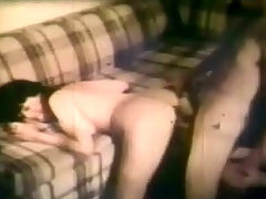 Girl with big tits fucking : A girl in bikini is sitting on a couch. A guy next to her is kissing her tits and rubbing her body all over. He takes out one of her tits and licks the nipple. A little later she bends over the couch so he can fuck her from behind.