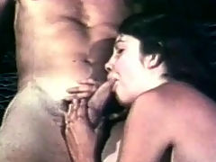 Dildo threesome : A guy and a girl are passionately kissing with each other whil he is taking her clothes off. A little later he is sitting down while she sucks his cock. Thy move into 69 position so he can lick her pussy before he fucks her with a large dildo.