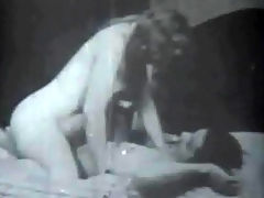 A hard fuck : In this black and white movie a young blonde woman is showing her naked body off to a man who is laying on a bed. A little later she climbs on top of him, shoving his dick into her pussy and fucking him. Then she gives him a blow job until he comes.