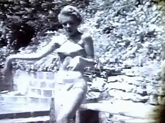 Erotic dancer at work : In this black and white movie we see Sheree North, an exotic dancer, dressed in a panther suit. She is dancing on a terrace in the garden, swaying her body to and fro. A little later she appears again, this time in a tight bikini.