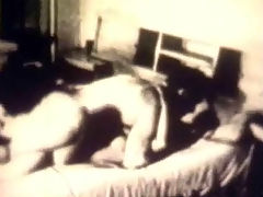 Black and white threesome : A couple is on the bed, fucking each other. A little later they are joined by a second girl who watches them, rubbing her tits while the first girl sucks the guys dick and he licks the pussy of the new arrival.