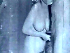 Fucking in black and white : A middle aged couple is on a bed. They lay down and begin to kiss. A little later the woman is naked and the guy is rubbing her pussy. He takes off his clothes too and she plays with his dick before the two of them lay down on the bed again in order to fuck.