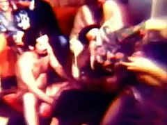Hippie orgy : In this movie from the sixties we see a large group of people in a living room. They slowly undress each other until most of them are naked. Two of the girls get to the middle of the room to dance with each other.