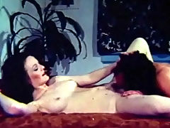 A hot massage : A woman is laying naked on a bed. At the other end of the room a guy is undressing. He joins her on the bed and gives her a massage, squeezing her tits. Then he licks her hairy pussy before she climbs on top of him for a fuck.