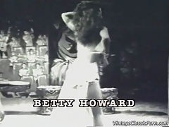 Big titted Betty Howard : In this classic piece of film we see Betty Howard dancing to jazz music. She is wearing the outfit of a harem girl and while she dances she removes her clothing bit by bit until she is wearing only a bikini.