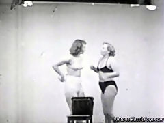 Vintage cat fights : In this vintage movie we see two girls in bikini fighting with each other in a studio. They try to wrestle each other to the floor. In the second part we see two female wrestlers fighting each other in the ring.
