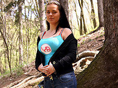 Blow job in the forest : A young girl is walking through a forest. She stops and slowly takes her coat off. The camera lowers the girls bra and a little later she is on her knees, sucking his cock. The guy then jerks off and comes in her face.