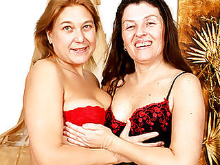 Greedy Grannies Roberta and Tatiana Munching On Pussy : I didnt know grannies could be so HORNY, especially lesbians as juicy as Roberta and Tatiana! After making out, these mature dirty birds lay on top of each other, using their tongues to explore their fabulous figures. Then, they break out a double-headed dildo and fuck each other silly with it at the same time! Watch out for Roberta - shes one greedy carpet-munching slut!
